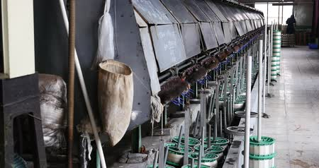 silkworm : Machine Producing Tissues In A Silk Factory,Spinning Machine Collect silk Threads,silk textile factory production line,Workers reeling at workshop.