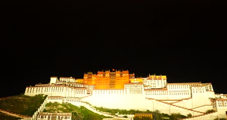 szerzetes : Brightly lit Potala at night in Lhasa,Tibet. Stock mozgókép