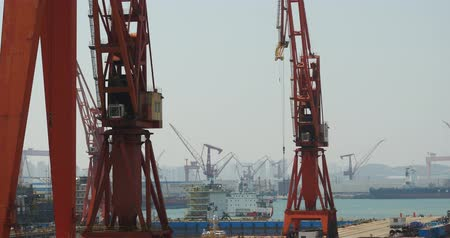 tersane : 4k Industrial working crane bridge in shipyard. Stok Video
