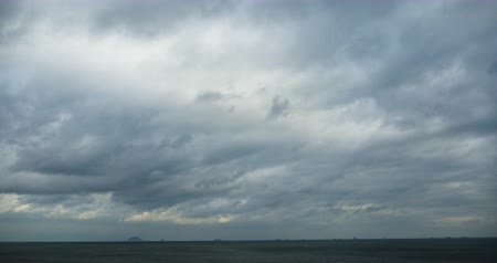 beach panorama : 4k sparkling ocean sea water waves surface and coastal rock reef coast cloud cloudscape. Dark clouds. Altocumulus, high cumulus cloud, mackerel sky. Stock Footage