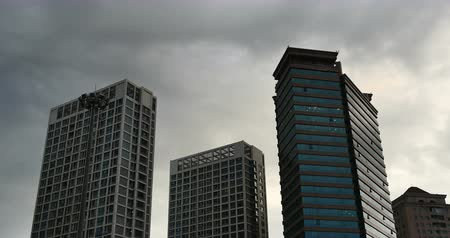 altocumulus : 4k Altocumulus clouds in sky over CBD office buildings high-rise & skyscraper at urban city. Stock Footage