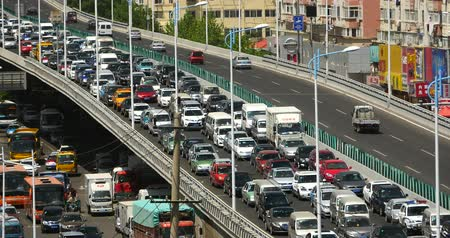 europe population : Modern urban city busy traffic jams on overpass,highway street  business houses building.transportation travel road. Stock Footage
