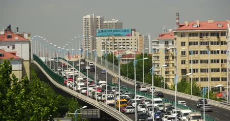 casas : Modern urban city busy traffic jams on overpass,highway street  business houses building.transportation travel road. Vídeos