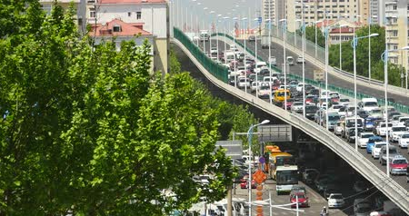 interseção : Modern urban city busy traffic jams on overpass,highway street  business houses building.transportation travel road. Stock Footage