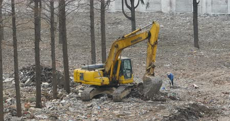 oco : excavator working  dumper truck on construction site,china. Stock Footage