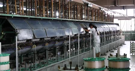 kumaş : Machine Producing Tissues In A Silk Factory,Spinning Machine Collect silk Threads,silk textile factory production line,Workers reeling at workshop.
