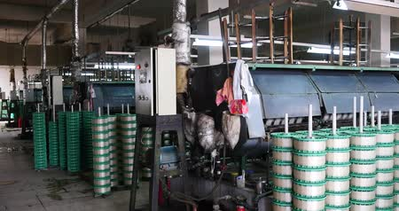 busy line : Machine Producing Tissues In A Silk Factory,Spinning Machine Collect silk Threads,silk textile factory production line,Workers reeling at workshop.