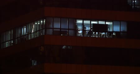şantiye : Office building windows lighting at night  urban architecture glass house. Stok Video