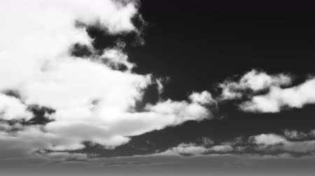duch : timelapse running clouds cover sun,black & white.