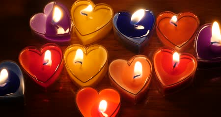 evangélium : Candles burning in the night,heart shape,Merry Christmas And Happy New Year.