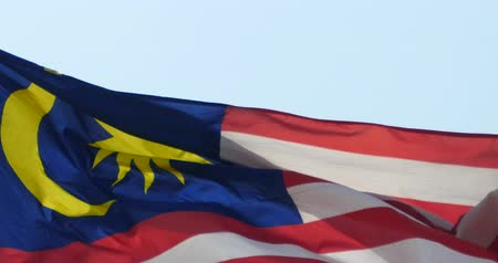ue : Malaysia flag is fluttering in wind.