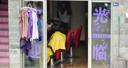 shangri la : young girl gets a haircut in tonsorial,shangri-la yunnan,china. Stock Footage
