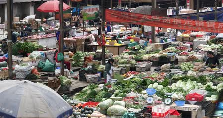 shangri la : large outdoor vegetable trade market in Shangri-La,china,minority women,variety of vegetables & fruits.