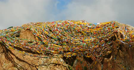 tramp : Prayer flags at the lake namtso in tibet,ancient holy monk meditation in cave,ZhaXi Peninsula,tibet mansarovar