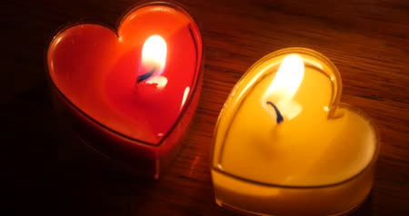 годовщина : Candles burning in the night,heart shape,Merry Christmas And Happy New Year.