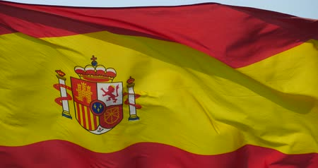 spaniard : Spain flag is fluttering in wind.