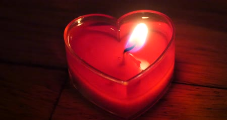 égő : Candles burning in the night,heart shape,Merry Christmas And Happy New Year.