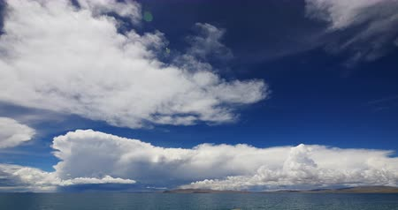 inculto : time lapse of huge clouds mass rolling over lake namtso & Tanggula snow mountain peak,tibet mansarovar,Tibets second largest lake,is the third largest saltwater lake in China.Danggula(Tanggula) Mountains in xizang Plateau,roof of the World.