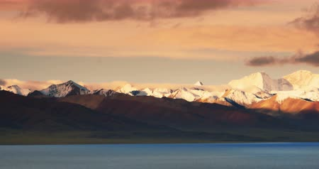 geological feature : huge clouds mass rolling over lake namtso & Tanggula snow mountain peak,tibet mansarovar,Tibets second largest lake,is the third largest saltwater lake in China.Danggula(Tanggula) Mountains in xizang Plateau,roof of the World.