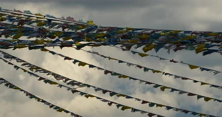 божество : prayer flag in wind,clouds background.