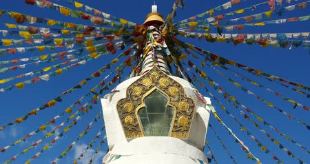 tanítvány : buddhist white stupa & flying prayer flags with blue sky background,shangrila yunnan,china.