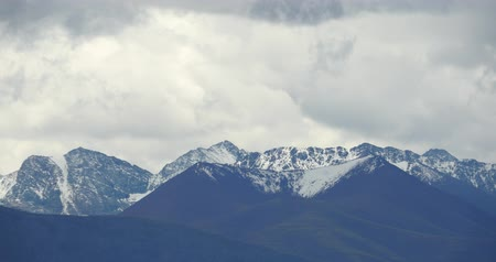 tramp : huge clouds mass rolling over Tanggula snow mountain peak,Danggula(Tanggula) Mountains in xizang Plateau,roof of the World.