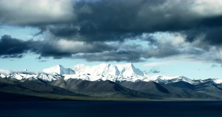 tramp : time lapse of huge clouds mass rolling over lake namtso & Tanggula snow mountain peak,tibet mansarovar,Tibets second largest lake,is the third largest saltwater lake in China.Danggula(Tanggula) Mountains in xizang Plateau,roof of the World.
