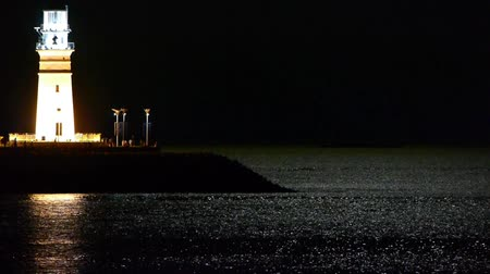 балки : Lighthouse at night,moon light reflect on sea. Стоковые видеозаписи
