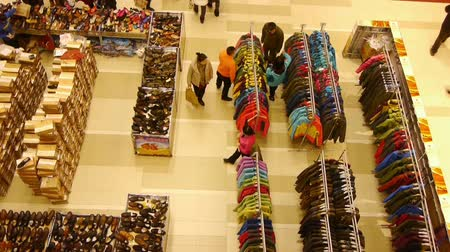аккуратный : lookdown people shopping for clothes & shoes in shopping mall,china.consumer selection of clothing.