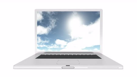 bulutluluk : Laptop play video of sunny day,time lapse of clouds flying through blue sky,Coming from a distance.