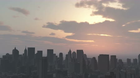 panorâmico : Urban sunset,cloud flying over New York,modern business building silhouette.