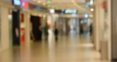 peoples : customer in the shopping malls scene,Blurry crowd silhouette,modern city environment.