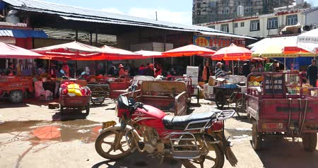 bakkal : variety of food & Life items in large outdoor trade market Shangri-La,china,busy crowd on the marketplace.