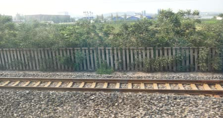 vago : Speeding train travel,scenery outside window.train-station rail.