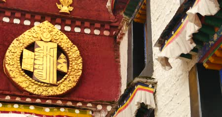 tibeti : closeup of The Jokhang Temple In Lhasa,Tibet,white clouds in blue sky. Stock mozgókép