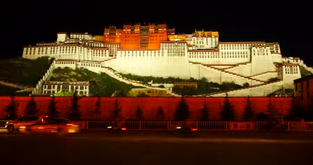 sziámi : busy traffic in front of the Potala at night in Lhasa,Tibet.