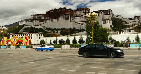 pagode : busy traffic & crowd in front of potala in lasa,tibet.