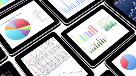 common : Mobile devices,finance pie charts & stock trend diagrams Stock Footage
