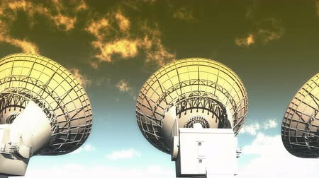 parabola antenna : Satellite Dishes at dusk,Very Large Radio Observatories,Military Radar,Space exploration. Stock Footage
