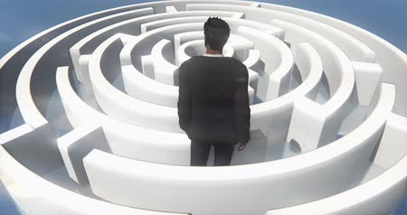 dificuldade : a businessman standing in the maze.