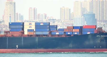 busiest : 4k Cargo Container Ships Through The QingDao Harbo,moder urban building,china.