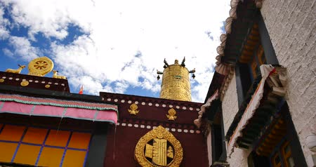 tibeti : 4k closeup of The Jokhang Temple In Lhasa,Tibet,white clouds in blue sky.