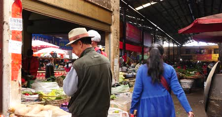 bakkal : 4k variety of food & Life items in large outdoor trade market Shangri-La,china,busy crowd on the marketplace.