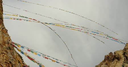 tramp : 4k Prayer flags at the lake namtso in tibet,ancient holy monk meditation in cave,ZhaXi Peninsula,tibet mansarovar