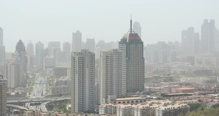 население : 4k urban city busy traffic jams,QingDao,china.highway street & business houses building,air pollution.
