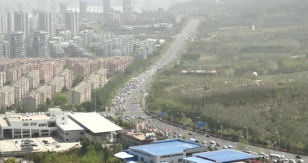 interseção : 4k china urban city busy traffic jams,highway street & business houses building,air pollution.