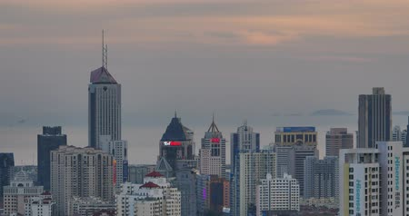 time flow : 4k urban city in dusk,busy traffic jams & business building,QingDao,china. Stock Footage