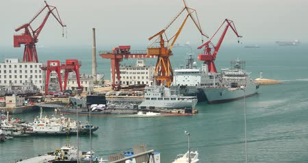 mühendislik : Industrial working crane bridge in shipyard,Ship into port,Qingdao china. Stok Video