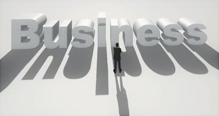 seçme : 4k businessman standing on the front of 3d business sign.