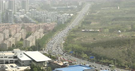 güvenli : 4k timelapse china urban city busy traffic jams,highway street & business houses building,air pollution.